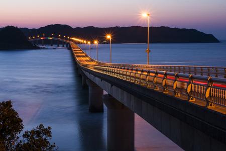light up: Orange light up Tsunoshima Ohashi bridge over sea in Shimonoseki, Yamaguchi at twilight