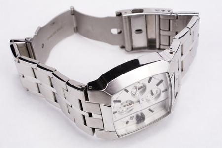 cronografo: reloj cuadrado Tipo de cronógrafo en un fondo gris claro