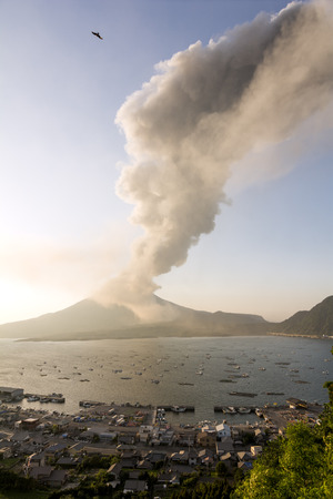 plume: Sakurajima volcanic plume and many small fishing boats in Tarumizu, Kagoshima