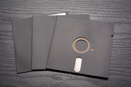 disks: Three 5.25 inch floppy disks on black desk