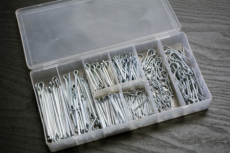 hairpin: Assortment cotter pins in divided plastic container Stock Photo