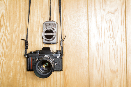 hung: Hung old camera and exposure meter on the wood wall