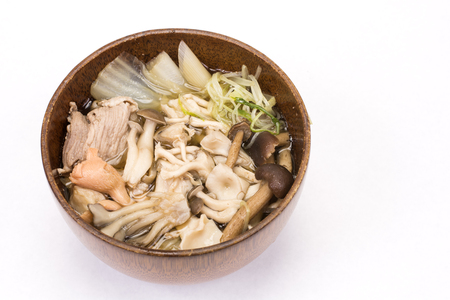 salmon falls: Various mushroom and vegetables, meat soup in wood bowl