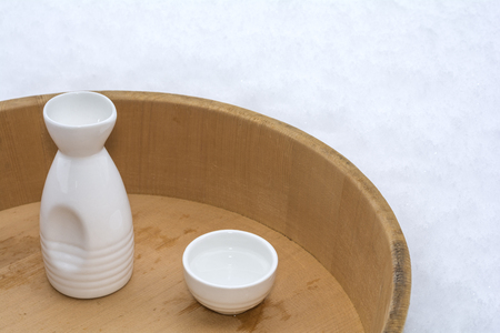 Tokkuri (sake bottle) and Ch?k? (small sake cup) on wood tub with snow