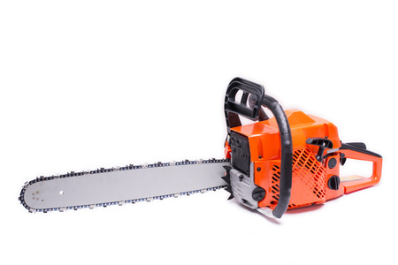 Engine powered chain saw placed sideways on white background