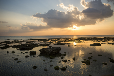 A lot of stone and rock rose out of the sea at evening in Senagajima, Okinawa