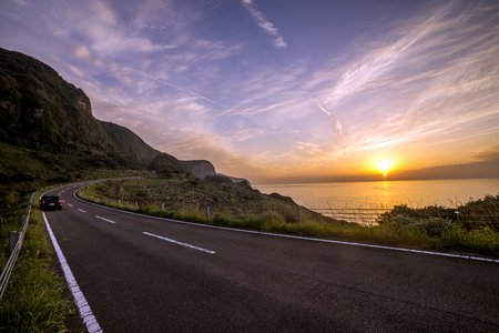 travelled: Evening roadway in front of sea with sinying sun in Ikitsuki, Nagasaki