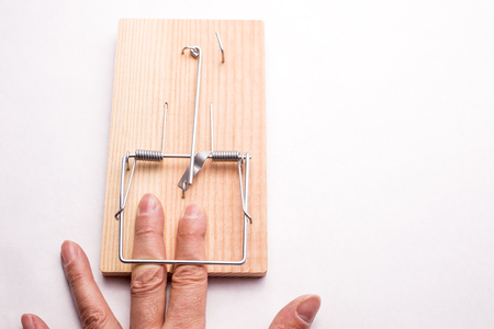seize: Finger caught by the mousetrap device on white background Stock Photo