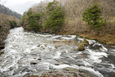 Ryuzu waterfall flowing down on rock slope in Nikko 写真素材