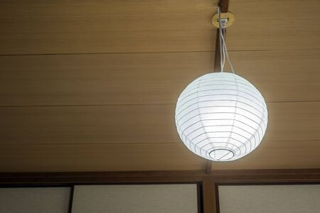Illuminated Japanese style LED pendant lighting hung from the ceiling