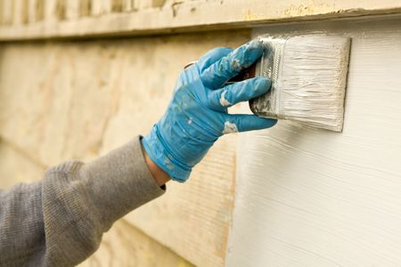 Painting the house with white paint photo