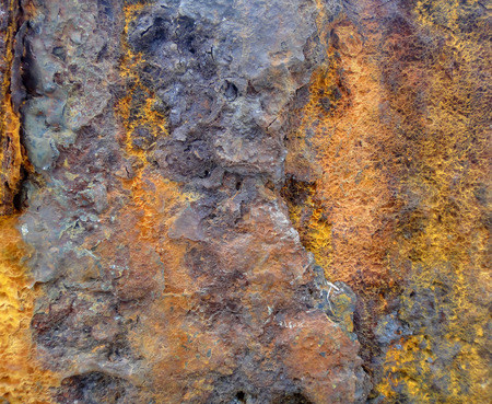 corrode: The surface of rusty metal