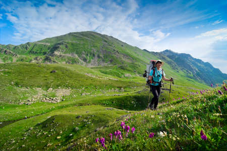 woman hiking in the mountain photo