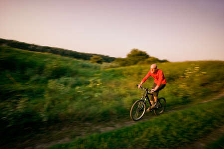 man extreme biking in motion Stock Photo - 13369659