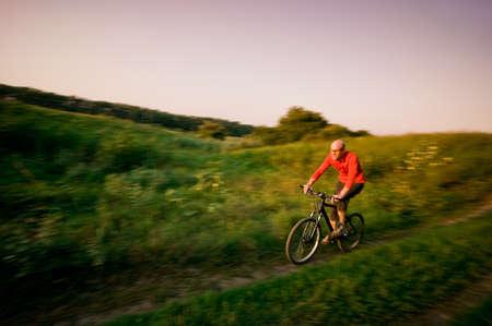 man extreme biking in motion Stock Photo - 13369659