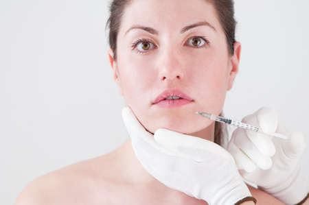 a woman getting botox injection Stock Photo - 13369858