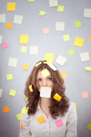 secretary overwhelmed with sticky reminder notes photo