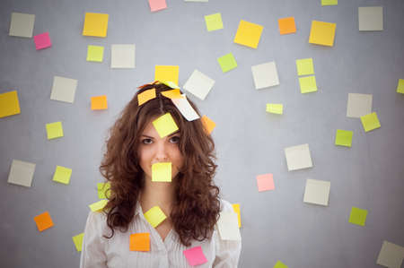 secretary overwhelmed with sticky reminder notes Stock Photo - 13369655