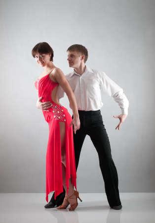 couple dancing on grey background photo