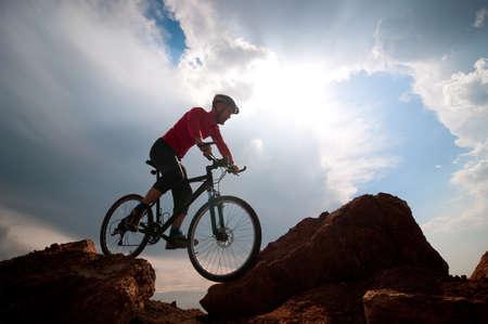extreme terrain: man mountain biking over extreme terrain Stock Photo