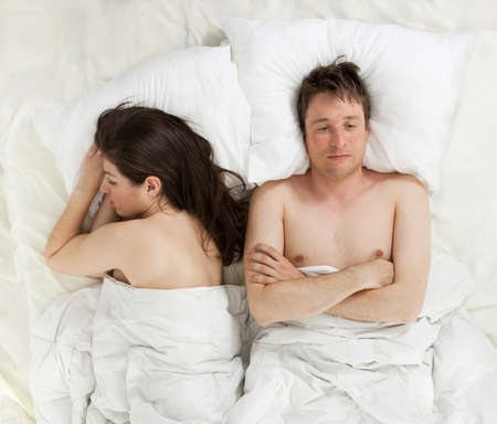 a couple lying in bed Stock Photo - 13369650