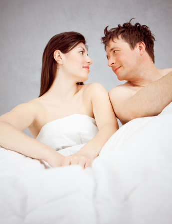 a couple sitting in bed Stock Photo - 13369860