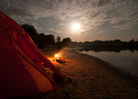 expedition: tent and campfire at night