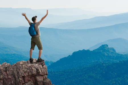 man hiking in mountains Stock Photo