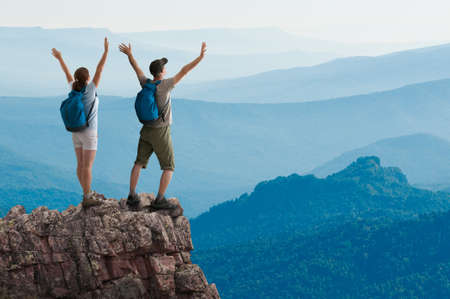 woman hiking: couple hiking in the mountains Stock Photo