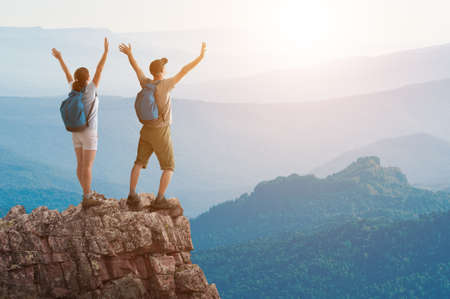 mountaineering: couple hiking in the mountains Stock Photo