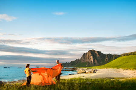 camping tent: couple with tent near seaside