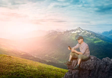 man working outdoors with tablet pad Stock Photo