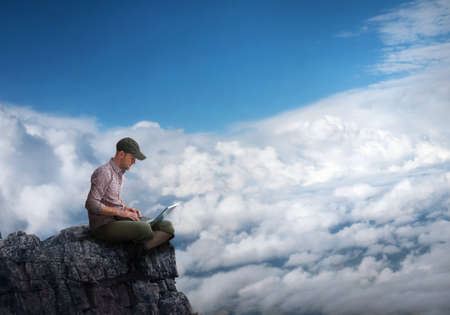 man working outdoors with laptop photo