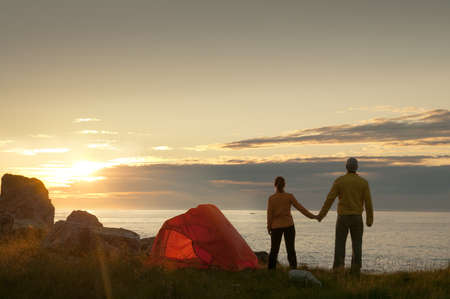 couple with tent near seaside photo