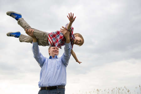 family support: father with son having fun