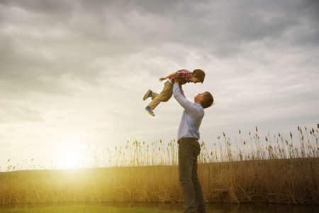 fatherhood: father with son outdoors
