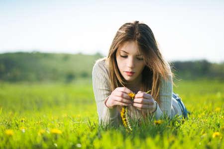lying on grass: summer girl lying in meadow