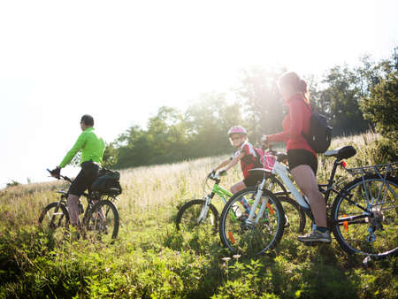 family cycling in summer