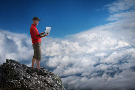 man working outdoors with laptop Stock Photo - 20659796