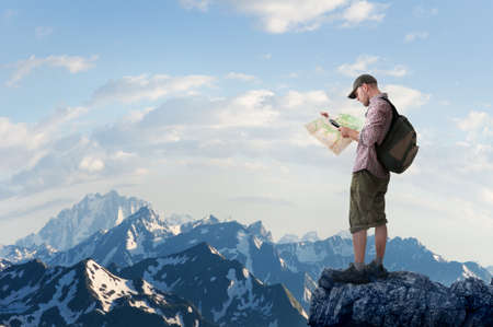 man hiking in mountains Stock Photo