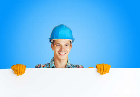 redecorate: worker with blank board on white isolated