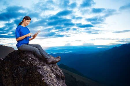 woman working outdoors with tablet pc photo