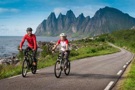 two cyclists relax biking in Norway Archivio Fotografico