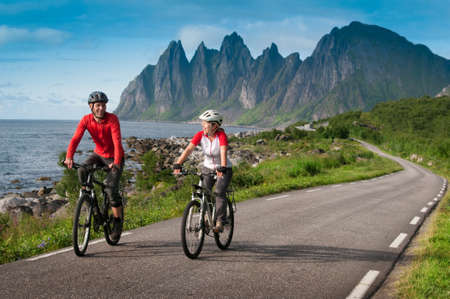 norge: two cyclists relax biking in Norway Stock Photo