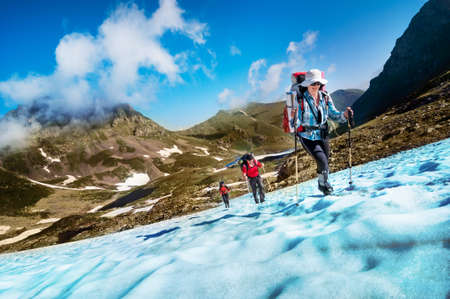 expedition: group hiking in mountains