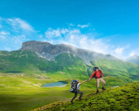 couple hiking in mountains photo