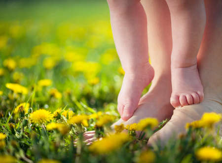 barefoot people: baby learning to walk