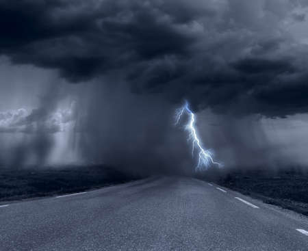 lightnings: Dark stormy clouds over road