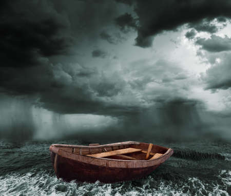 old boat in the stormy ocean photo