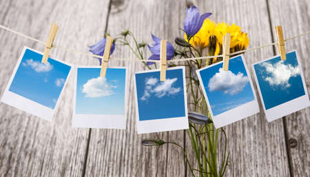 polaroids: prints with clouds pictures